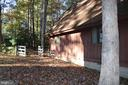Side with gate to back yard - 991 LAKE HERITAGE DR, RUTHER GLEN