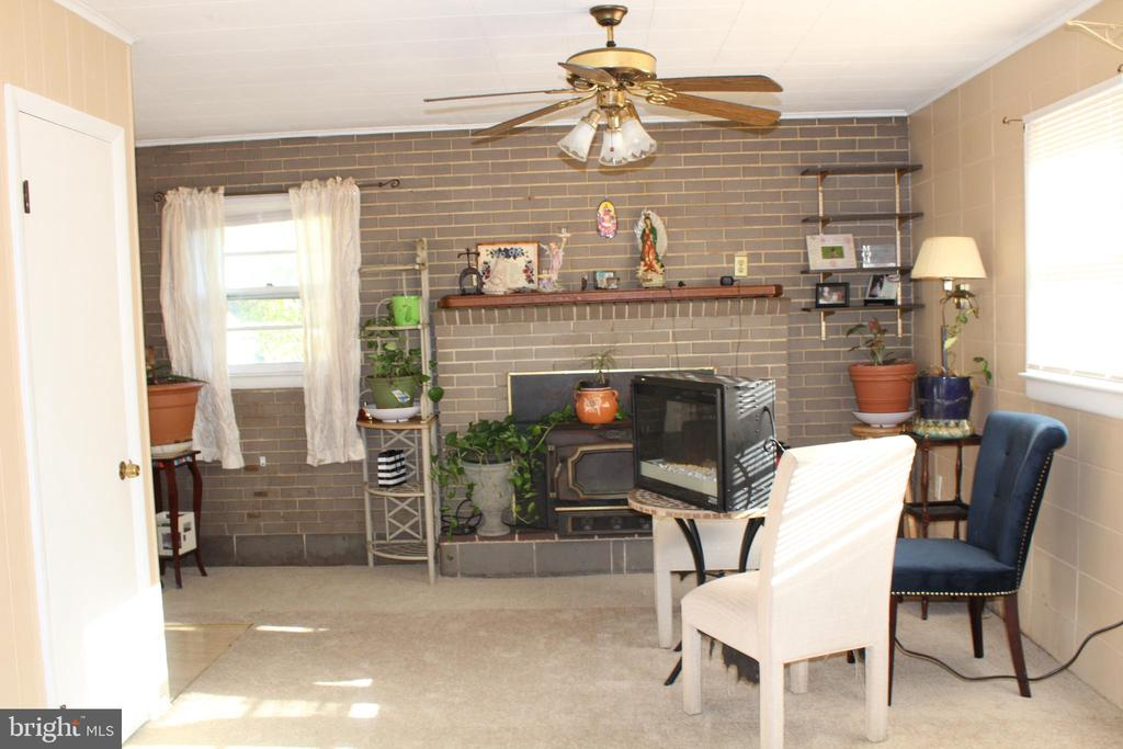 Family room addition with fireplace - 6909 RANDOLPH ST, HYATTSVILLE