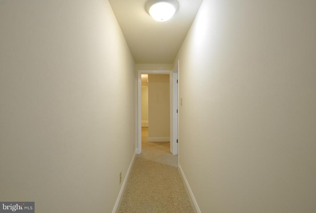 Hallway leads to Garage - 308 WESTOVER PKWY, LOCUST GROVE