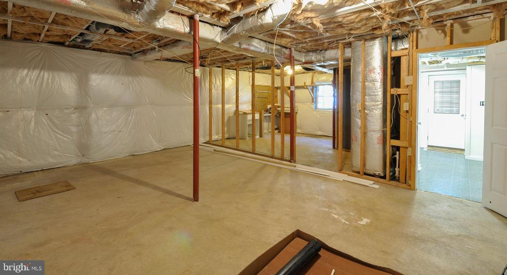 Two Unfinished Rooms for Storage in Lower Level - 308 WESTOVER PKWY, LOCUST GROVE