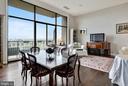 Living room, balcony is the whole width of room. - 1401 N OAK ST #309, ARLINGTON