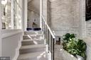 Exposed white-washed brick stairwell - 3306 R ST NW, WASHINGTON