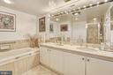 En-suite master bath with dual sink vanity - 5600 WISCONSIN AVE #202, CHEVY CHASE
