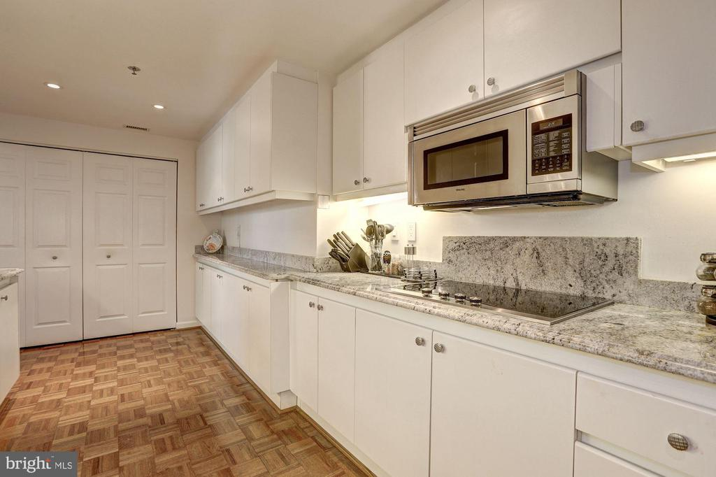 Kitchen with beautiful hardwood floors - 5600 WISCONSIN AVE #202, CHEVY CHASE