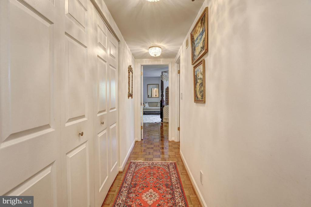 Hall leading to the bedroom suites - 5600 WISCONSIN AVE #202, CHEVY CHASE