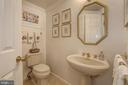 Half bath off of foyer - 5600 WISCONSIN AVE #202, CHEVY CHASE