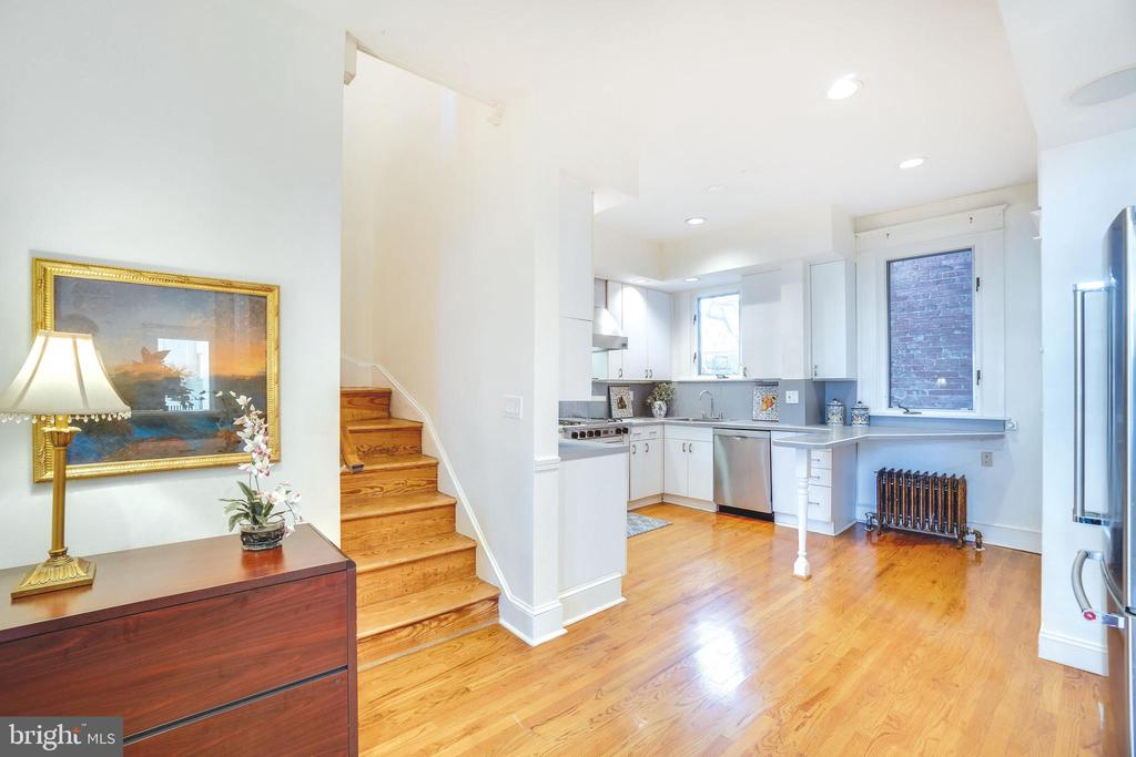 The open kitchen has enough room for dining too - 1755 18TH ST NW, WASHINGTON