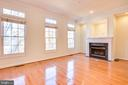 Main Level w/ Gas Fireplace & Wall of Windows - 1603 LEEDS CASTLE DR, VIENNA