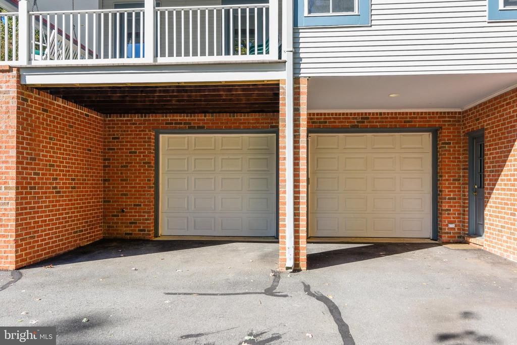 Two car garage with two more covered parking spots - 916 MONROE ST, HERNDON