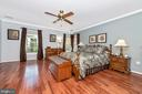 With the master bedroom with hardwood floors - 5745 STONEY CREEK CT, FREDERICK