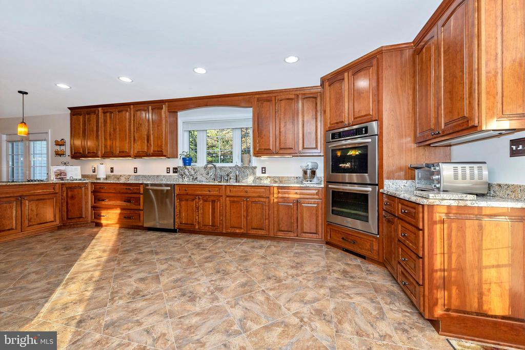 And an inviting kitchen with custom cabinetry - 5745 STONEY CREEK CT, FREDERICK
