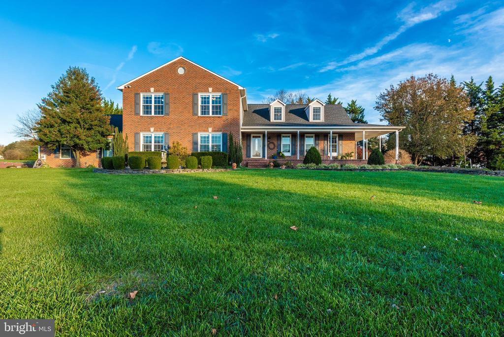 With a great front view of the home - 5745 STONEY CREEK CT, FREDERICK