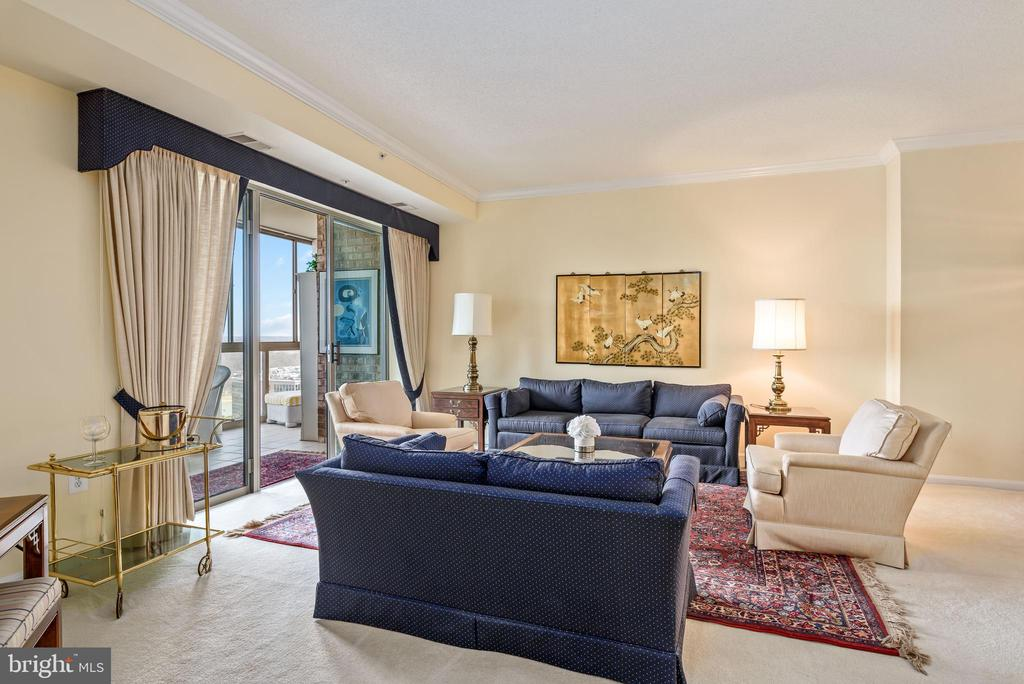 Open living room with access to sunroom. - 19355 CYPRESS RIDGE TER #615, LEESBURG