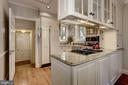 Updated kitchen with granite countertops - 3719 CHESAPEAKE ST NW, WASHINGTON