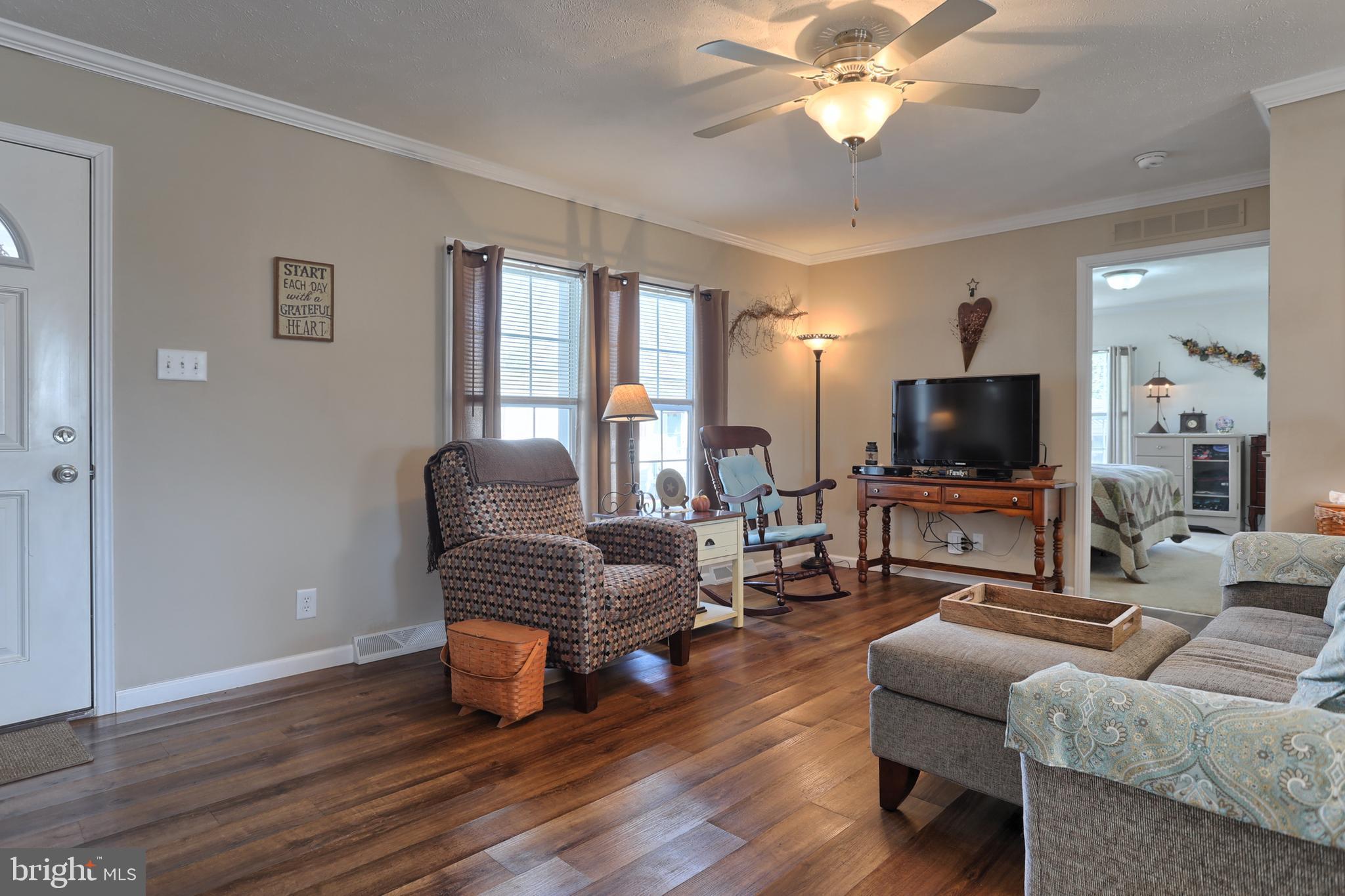 Drywalled walls and ceilings, wood floors