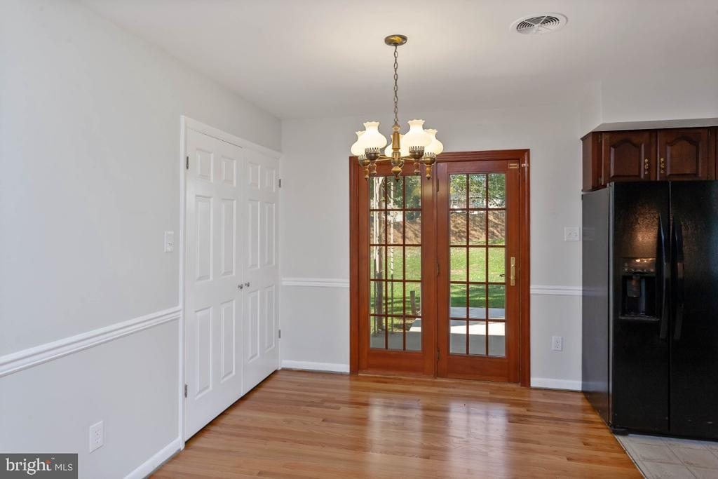 Dining room, doors out to  covered patio - 211 YOUNG AVE, BOONSBORO