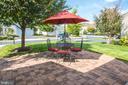 Custom Paver Patio overlooks plush grassy yard - 23082 BRONSTEIN LN, BRAMBLETON