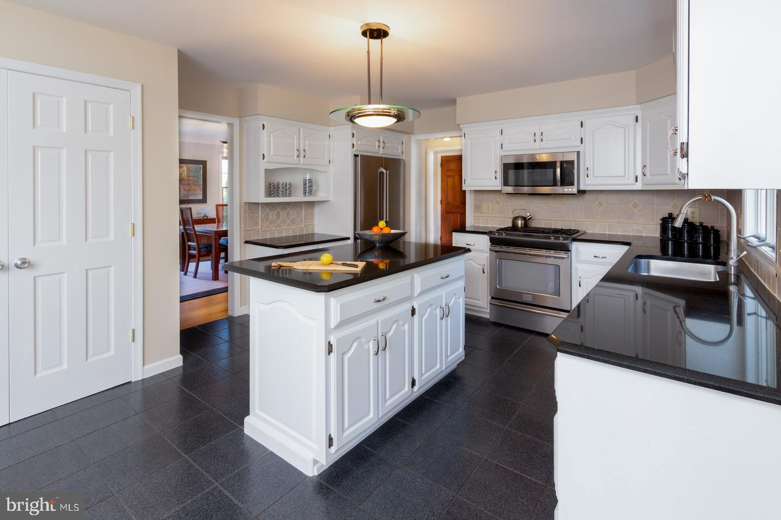 Bright White Kitchen w/ Stainless Steel Appliances