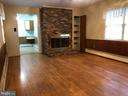 Family room with wood burning fireplace - 3608 UNIVERSITY DR, FAIRFAX