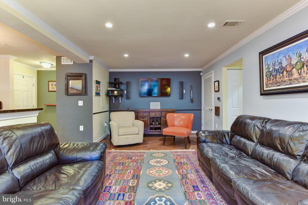 Living room with surround sound which conveys. - 4165 S FOUR MILE RUN DR #204, ARLINGTON