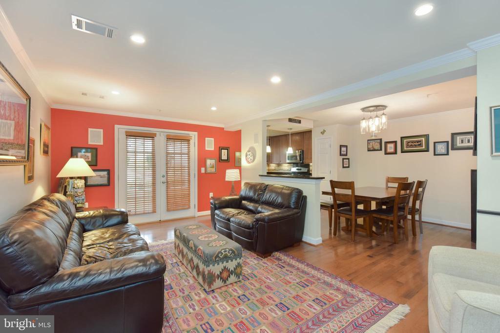 Living room has distressed birch wood floors. - 4165 S FOUR MILE RUN DR #204, ARLINGTON