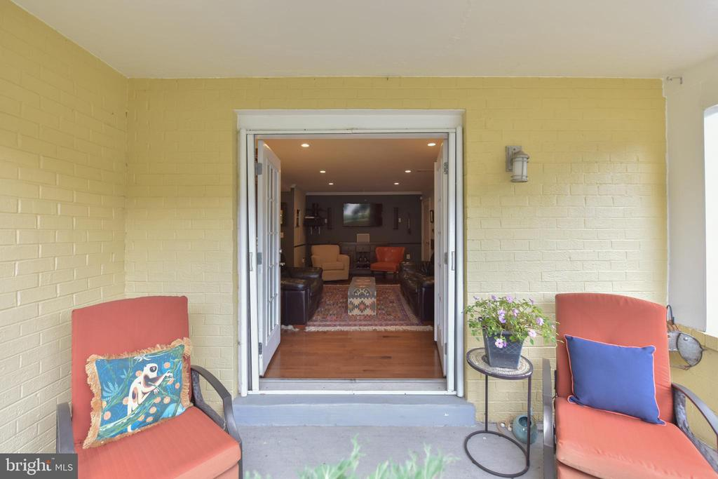Private, patio with French Doors to Living Room. - 4165 S FOUR MILE RUN DR #204, ARLINGTON