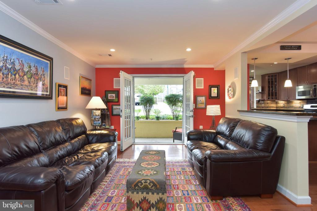 Living room with French doors that open to patio. - 4165 S FOUR MILE RUN DR #204, ARLINGTON