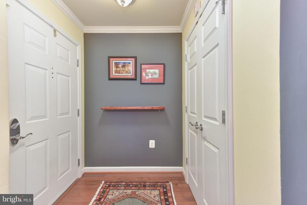 Foyer with coat closet. - 4165 S FOUR MILE RUN DR #204, ARLINGTON