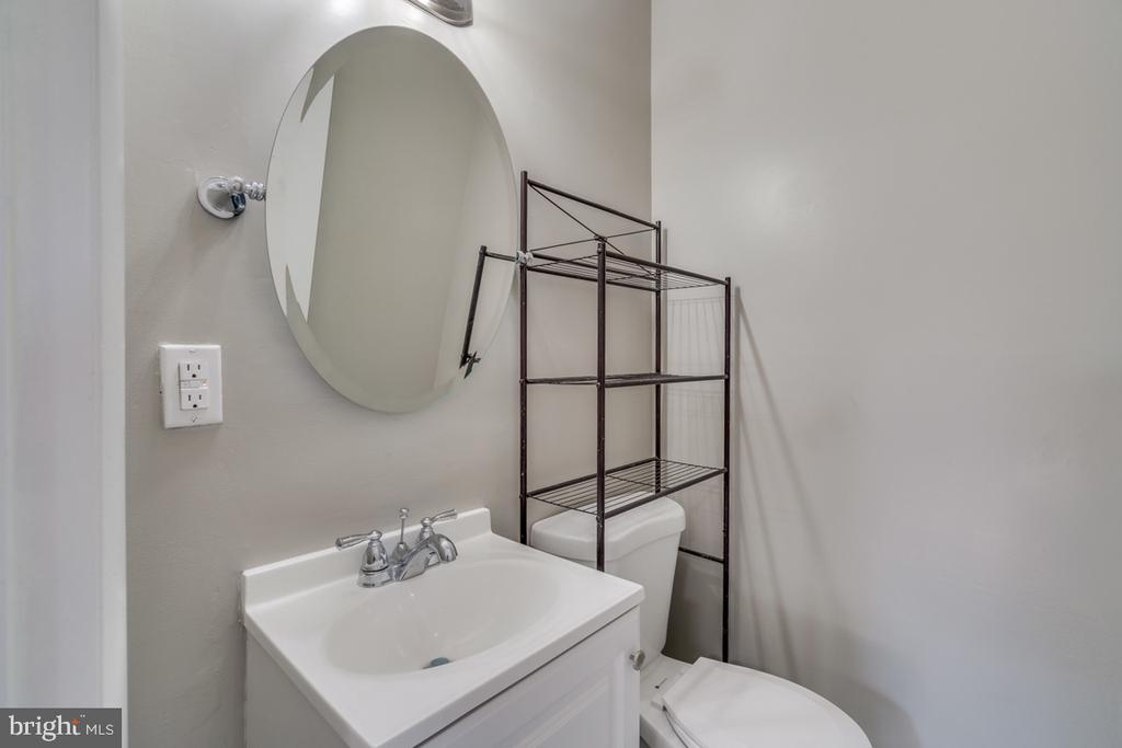 Master Half bath with all new fixtures. - 10619 KENILWORTH AVE #K-203, BETHESDA