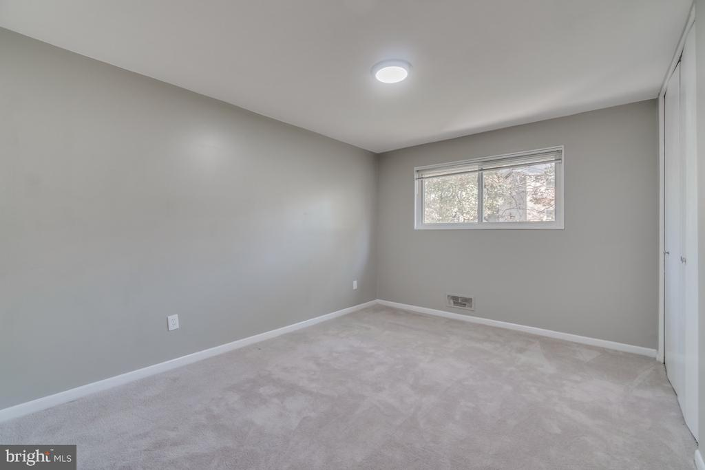 Larger second bedroom with new carpets. - 10619 KENILWORTH AVE #K-203, BETHESDA