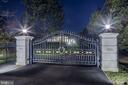 Custom iron gates introduce long private driveway - 11643 BLUE RIDGE LN, GREAT FALLS