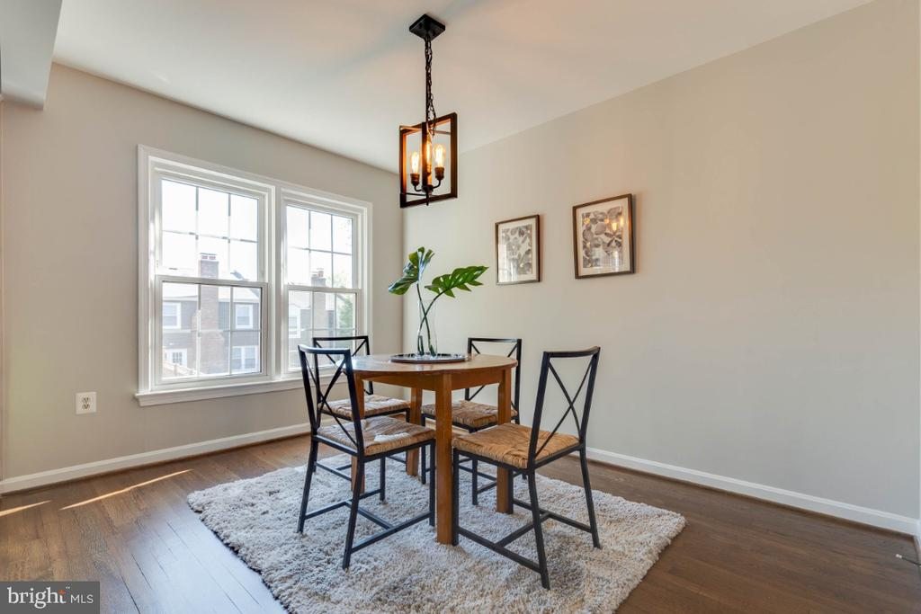 Dining area has an awesome new light - 1009 N TERRILL ST, ALEXANDRIA