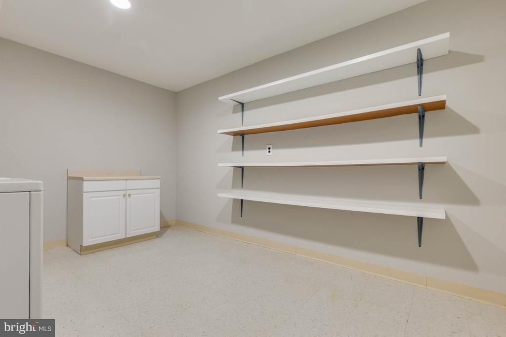 Laundry area has amazing storage as well - 1009 N TERRILL ST, ALEXANDRIA