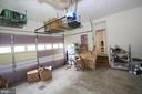 Large garage with storage - 21972 STONESTILE PL, BROADLANDS