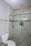 Remodeled hall bath shower- upper level - 21972 STONESTILE PL, BROADLANDS