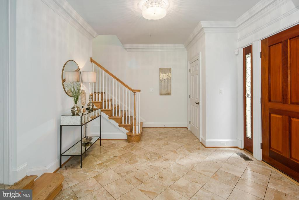 STAIRS TO SECOND LEVEL FROM FOYER - 1335 14TH ST N, ARLINGTON