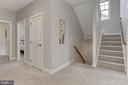 Foyer on Bedroom lvl w Linen Closet and Stairs Up - 23082 BRONSTEIN LN, BRAMBLETON