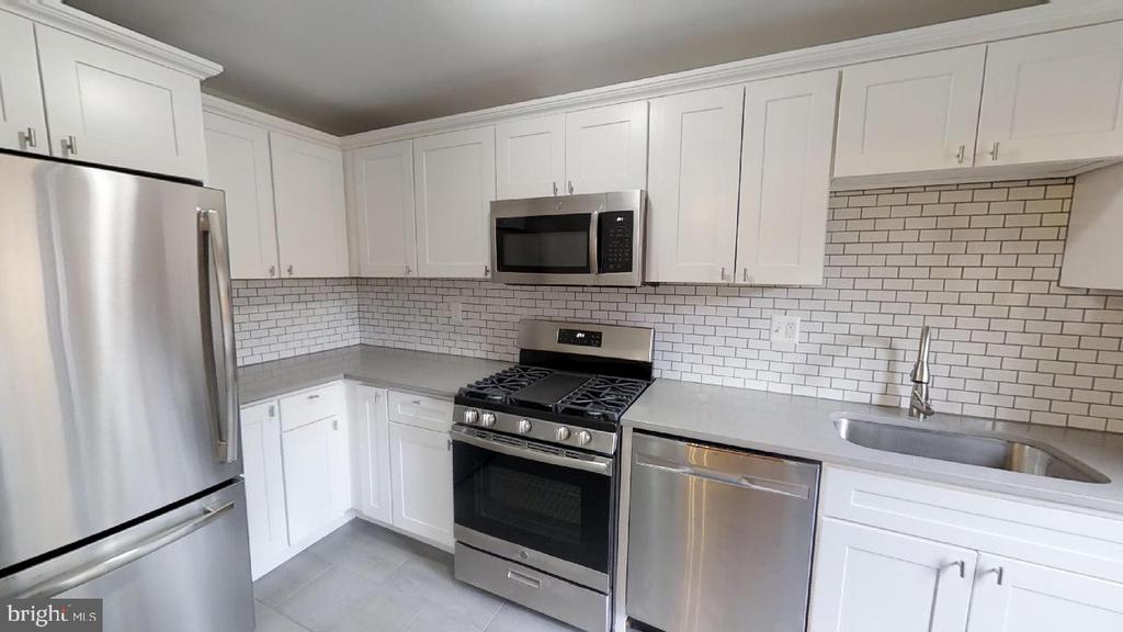 Kitchen shot 1 -- Stainless steel appliances - 2310 14TH ST NE, WASHINGTON