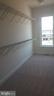 Master bedroom walk-in closet - 20373 CODMAN DR, ASHBURN