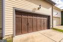 Large 2 car garage with large storage area above! - 191 GREAT LAUREL SQ SE, LEESBURG