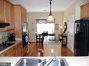 View of kitchen from living room - 239 WASHINGTON ST, LOCUST GROVE