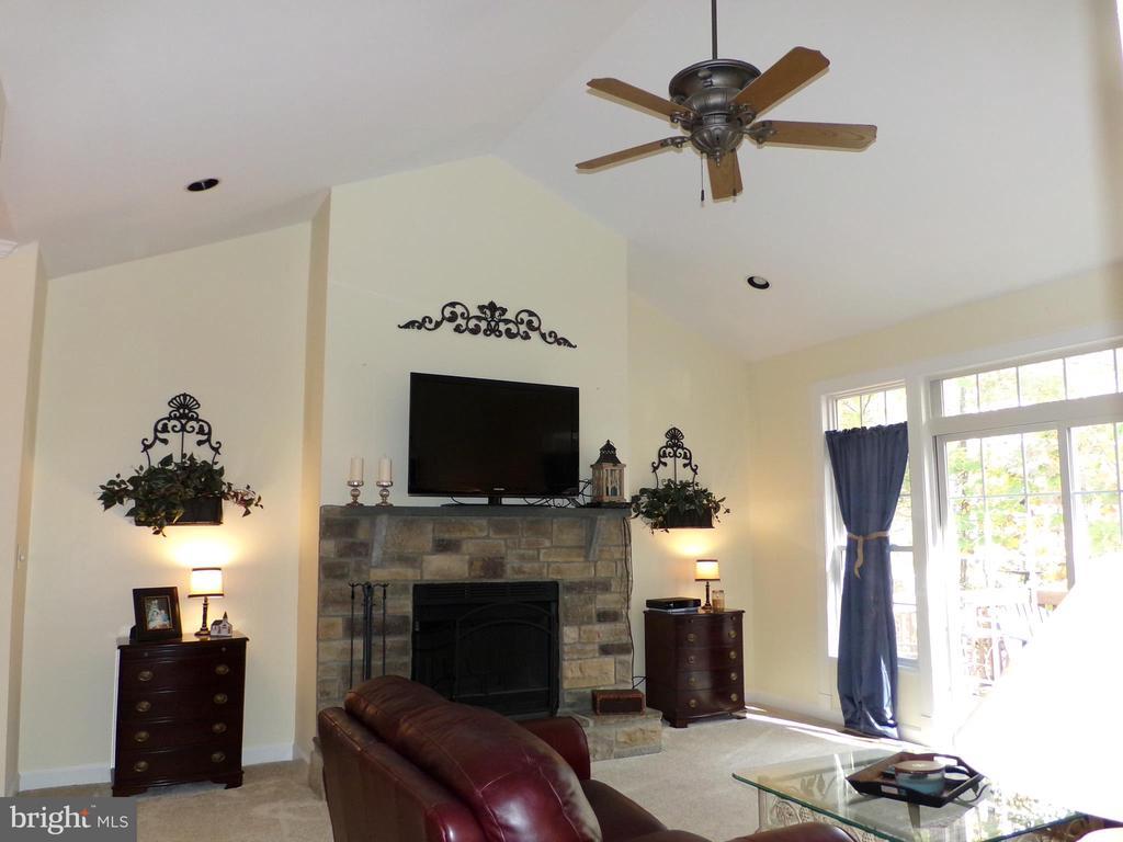 Livingroom with wood burning fireplace~~~ - 239 WASHINGTON ST, LOCUST GROVE