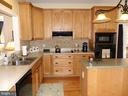 Kitchen with cook top, wall oven and microwave - 239 WASHINGTON ST, LOCUST GROVE