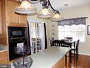 Kitchen with island and table area - 239 WASHINGTON ST, LOCUST GROVE