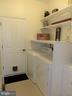 Laundry with built-in shelves and storage - 239 WASHINGTON ST, LOCUST GROVE