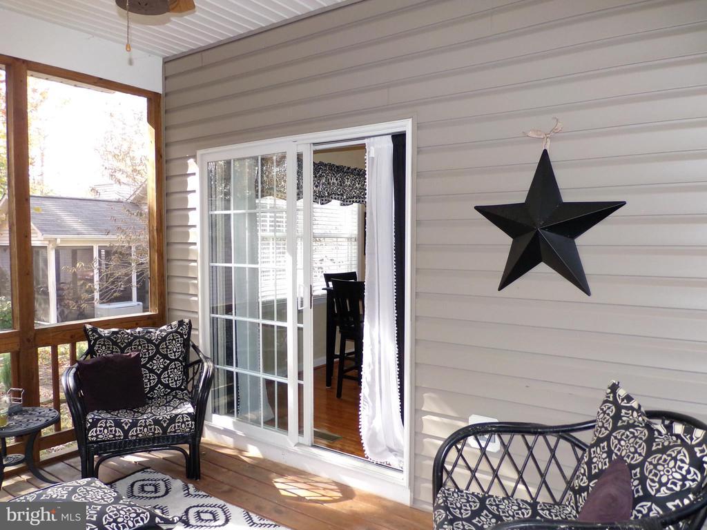 Screened porch leading to kitchen area - 239 WASHINGTON ST, LOCUST GROVE
