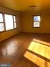 Light filled living room with hardwood floors. - 120 E CRISER RD, FRONT ROYAL