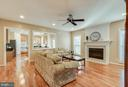 Open Family Room with Gleaming Hardwoods - 25565 UPPER CLUBHOUSE DR, CHANTILLY