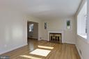 Large living room with woodburning fireplace - 4603 FRANKLIN ST, KENSINGTON