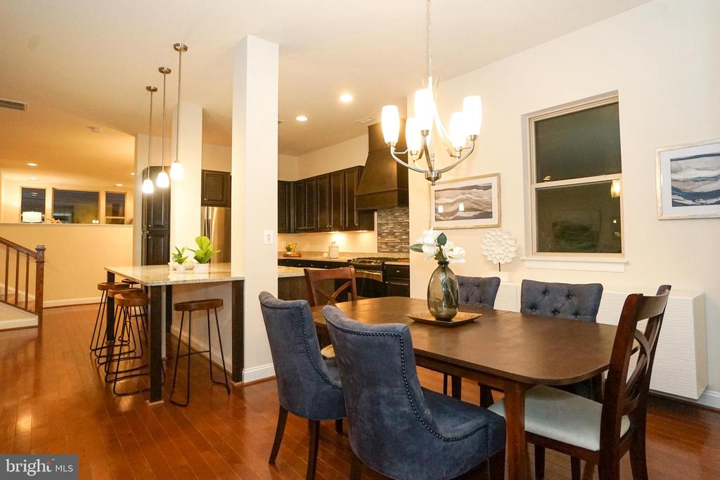 Dining Open to Kitchen and Family Room - 23326 EVENING PRIMROSE SQ, BRAMBLETON